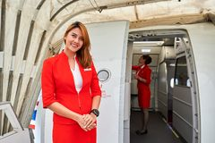 Thai AirAsia. MACAO - FEBRUARY 17, 2016:  crew member meet passengers of Thai AirAsia. Thai AirAsia is a joint venture of Malaysian low-fare airline AirAsia and Royalty Free Stock Photo