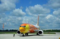 Thai aircraft marshaller marshalling and visual signalling betwe Stock Photos