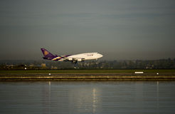 Thai Airlines 747 lands at Sydney International Airport Stock Photos