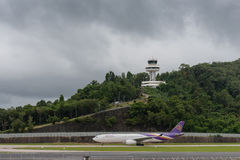 Thai airway and air traffic control tower. Thai airway taxi and air traffic control tower at phuket airport Stock Photos