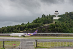 Thai airway and air traffic control tower. Thai airway taxi and air traffic control tower at phuket airport Stock Images
