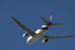 Thai Airways A320. A Thai Airways Airbus in flight, set against azure blue sky royalty free stock photography