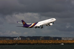 Thai Airways Airbus A340 jet taking off Royalty Free Stock Photography