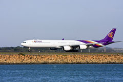 Thai Airways Airbus A340 jet taking off. Thai Airways Airbus A340 jet airliner on the runway Royalty Free Stock Photos