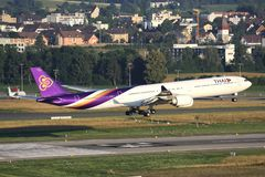 Thai Airways Airbus A340-600. Thai Airways International Airbus A340-600 with registration HS-TNC on short final for runway 34 of Zurich Airport stock image