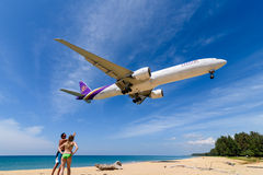 Thai airways airplane ,boeing 777, landing  at phuket airport Royalty Free Stock Photo
