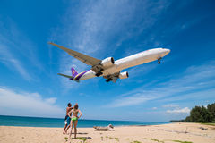 Thai airways airplane boeing 777 landing at phuket airport Royalty Free Stock Photography
