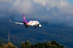 Thai Airways airplane landing at Chiangmai international airport. CHIANGMAI THAILAND - SEPTEMBER 2017 Thai Airways airplane landing at Chiangmai international Royalty Free Stock Photo
