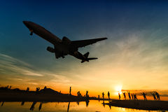 Thai airways airplane landing at phuket airport in evening Royalty Free Stock Photos