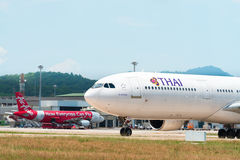 Thai Airways passenger plane taxis to the terminal at Phuket Int Stock Photography