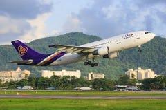 Thai Airways. Penang/Malaysia Februar 9, 2015: Airbus A300 from Thai Airways landing at Penang Airport Royalty Free Stock Photos