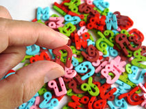 Thai alphabet toy. Colorful Thai alphabet toy with hand Royalty Free Stock Image