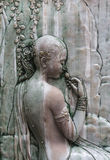 Thai ancient angel stone carving Stock Photo