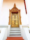 Thai ancient golden painting door at temple. Stock Image