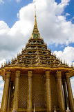 The Thai ancient golden statue is so beautiful in the blue sky day. The Thai ancient golden statue is so beautiful in the blue sky day at Wat Praputthabaht Royalty Free Stock Photo
