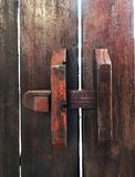 Thai Ancient padlock. Old wooden door with old locking system. Royalty Free Stock Photos