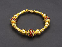 Thai ancient style golden bracelet Stock Images