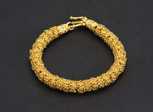 Thai ancient style golden bracelet Stock Photos