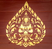 Thai Angel Art. Golden Thai-Style Angel Art on the Red Wooden Wall Royalty Free Stock Photography