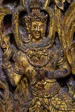 Thai angel. Old scratch wooden carve of thai angel in gold color Royalty Free Stock Photography