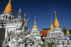Thai Angel and Stupas Royalty Free Stock Photos