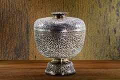 Thai antique ancient grunge silver bowl on wooden tabletop on vintage grunge wooden wall background. Still life Royalty Free Stock Image