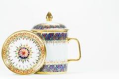 Thai antique porcelain drinking glass on white background Stock Photos