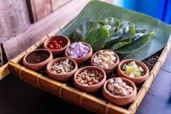 Thai appetizer called `Miang Kham`, some of nutritious snack wrapped in leaves with a sweet and salty sauce.  Royalty Free Stock Photography