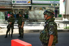 Thai army checkpoint on silom road. Near soi convent, 2 days after the violent clashes between the thai army and red shirts, bangkok, thailand Stock Photo