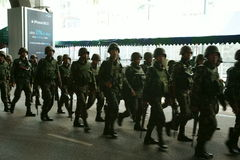 Thai army patrol in siam square. In front of paragon shopping complex, rama I road. This area has been claimed back from the red shirts pretesters on wednesday Stock Photo