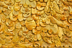 Thai art. Golden art on the wall at the temple Stock Photo