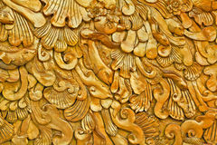 Thai art. Golden art on the wall at the temple Stock Photography