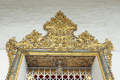 Thai art on the ancient door of the ancient Thai temple Royalty Free Stock Photo