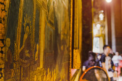 Thai art architecture Wall in church Wat Pho Temple of the Reclining Buddha with blurred tourist background Stock Image