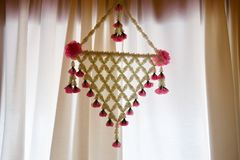 Thai art: artifact flower hang in window. Decoration in Thai style home Royalty Free Stock Photography