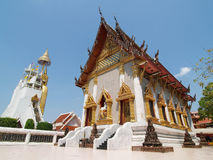 Thai art church with huge standing buddha. Church in Thai temple with huge standing buddha under blue sky, Bangkok, Thailand Stock Image