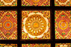 Thai art decorative ceiling at the temple of Thailand. Stock Photos