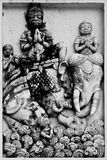 Thai art. The giants and elephant, sculpture from lime stock images