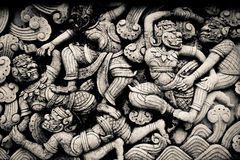 Thai art. The giants war, Thai art sculpture from lime royalty free stock photography
