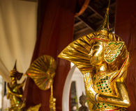 Thai art gold angel statue. Thai art paying respect gold angel sculpture statue Royalty Free Stock Images