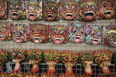 Thai art is a mask at Wat Pho.  stock image