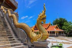 Thai Art, Naka statue on staircase. Thai Art, Single Naka statue on staircase balustrade at Thai Buddhist pagoda, Udornthani province, Northeast, Thailand Royalty Free Stock Photos
