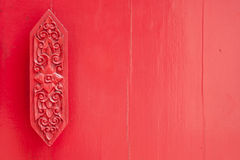 Thai art on red wall Stock Photography