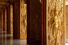 Thai art sculpture on the doors . Royalty Free Stock Photos