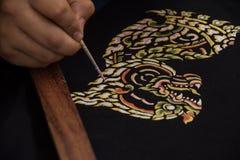 Thai art Singha on black fabric Royalty Free Stock Photo