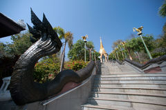 Thai art on staircase to Golden Pagoda in Wat Pa Phu Kon temple. Royalty Free Stock Image