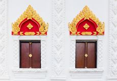 Thai art style of window in public temple with cha-da on top of Royalty Free Stock Photography