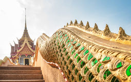 Thai art at temple. Thai art and design on scale of fantasy animal tail at the ladder of temple Stock Image