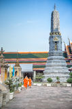 Thai art temple with monk and Jedi under blue sky, Bangkok, Thailand Royalty Free Stock Images