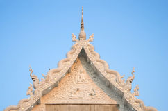 Thai art on temple roof under blue sky Royalty Free Stock Images